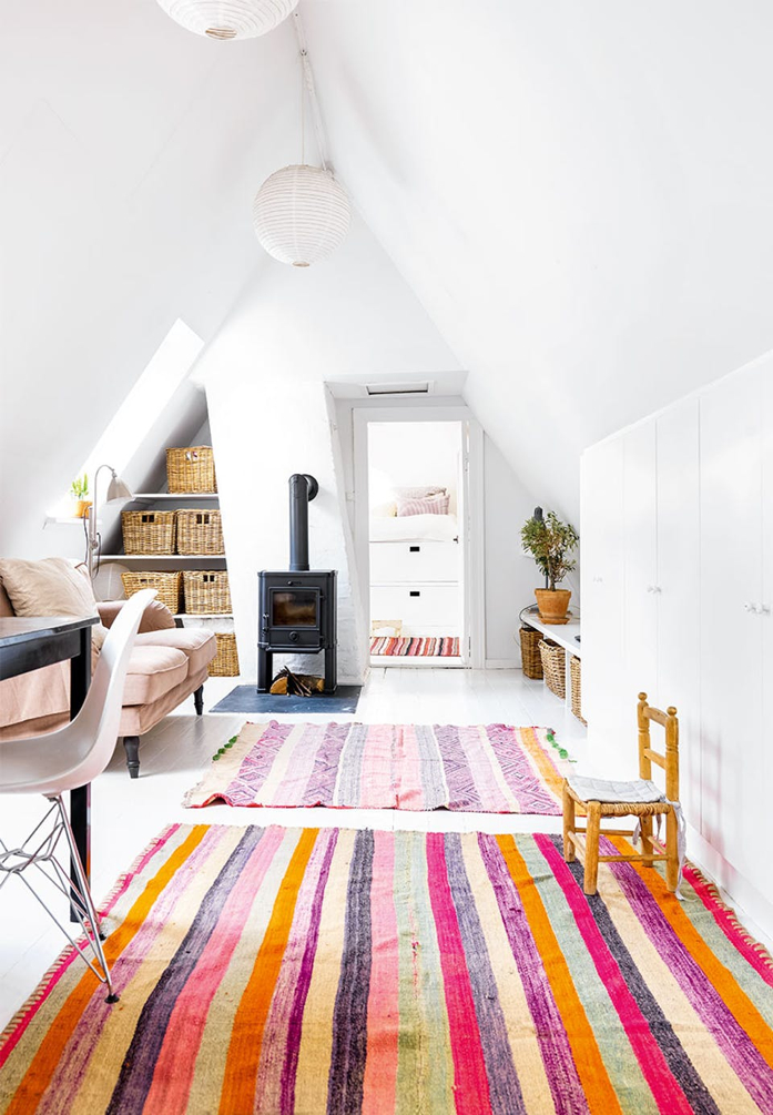Maximize space by using unexpected places like these nooks pictured as storage. Also those rugs adds a beautiful pop of color- design addict mom