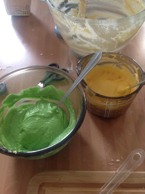 mixing rainbow cake batter