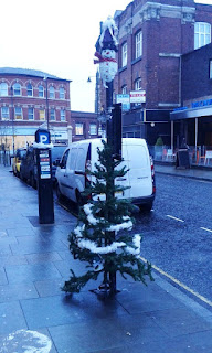 A Christmas tree on a Parking sign on St Petersgate in Stockport town centre.