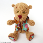 http://www.howtoamigurumi.com/amigurumi-bear-with-movable-legs-and-arms-free-pattern/