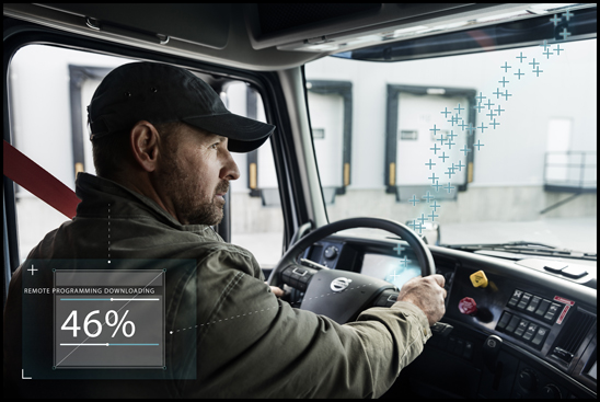 A truck driver utilizing the Volvo driver display activation