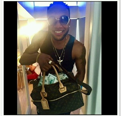 """Kcee flaunts bag of money on Instagram, tells his haters to """"shut up"""""""