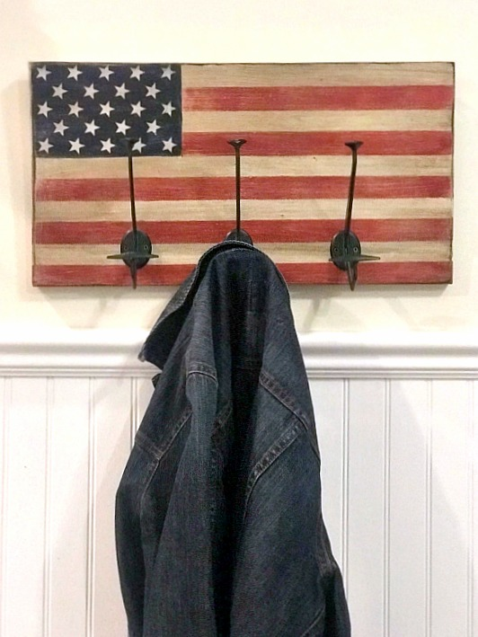 American Flag coat rack with extra large hooks for hanging coats or towels.