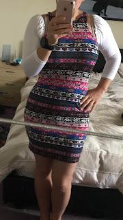 woman in long mirror in cute dress
