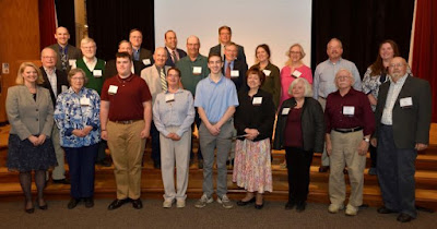 Group photo of volunteer of the year honorees on stage of State Museum auditorium