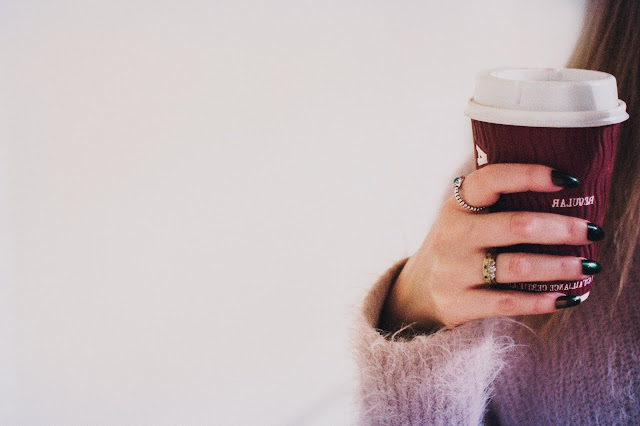 Girl Holding Coffee Cup Wearing Rings