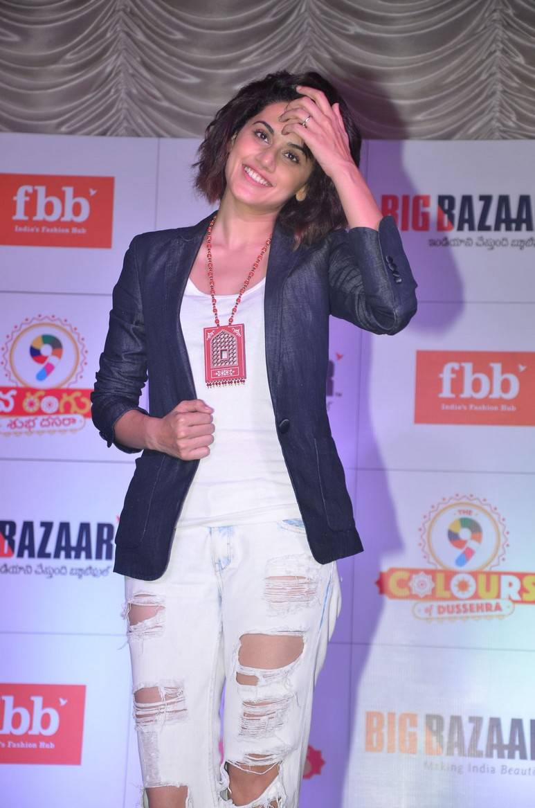 Tollywood Actress Taapsee Hot Smiling Photos In White Dress