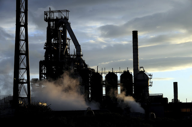 Image Attribute: One of the blast furnaces of the Tata Steel plant is seen at sunset in Port Talbot, South Wales, in this May 31, 2013 file photo. REUTERS/Rebecca Naden