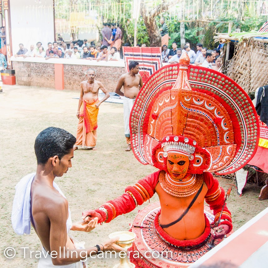 The next Theyyam made a grand entrance. He wore an enormous headgear than Pulimaran. It was while watching this Theyyam that the true hardship of being a Theyyam really struck me. With the heavy headgear and elaborate costume, this Theyyam performed for a long time, never once showing any sign of fatigue. The realization about the kind of hardwork that goes into performing a Theyyam was overwhelming. Full of respect for the professionals behind the customs, I watched rest of the Theyyams in awe.