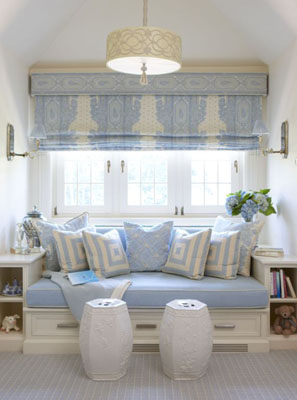 Blue and white built in window seat with blue and white roman curtains, Chinese garden jars as footstools and white book case