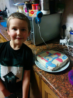 BB with his Cake. He drew Steve from Minecraft, but we only had blue, white and pink icing!