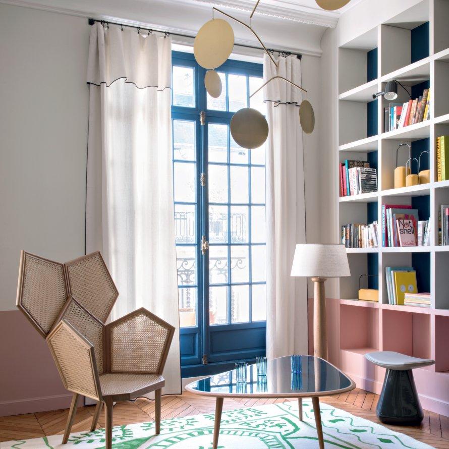 french apartment, interior design, retro coffee table, bookshelf, pastel colors