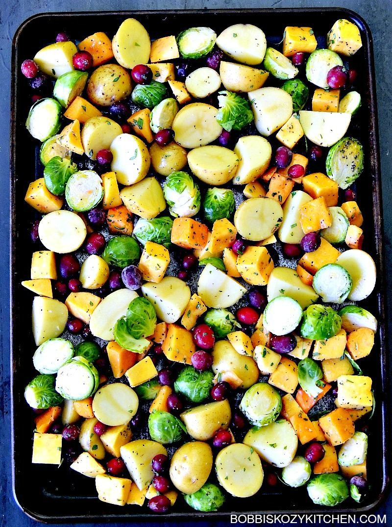 Cranberry Glazed Sheet Pan Chicken and Vegetables is the perfect fall flavored meal, that is easy to make, and uses just one pan, and is a meal your family will love any day of the week. From www.bobbiskozykitchen.com