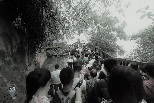 Walking down the stairway slowly while admiring Leshan Giant Buddha in Sichuan province of China