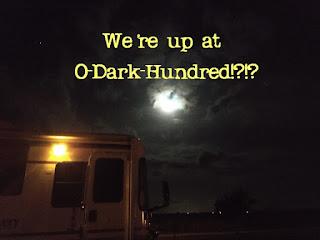 motorhome at night under a full moon
