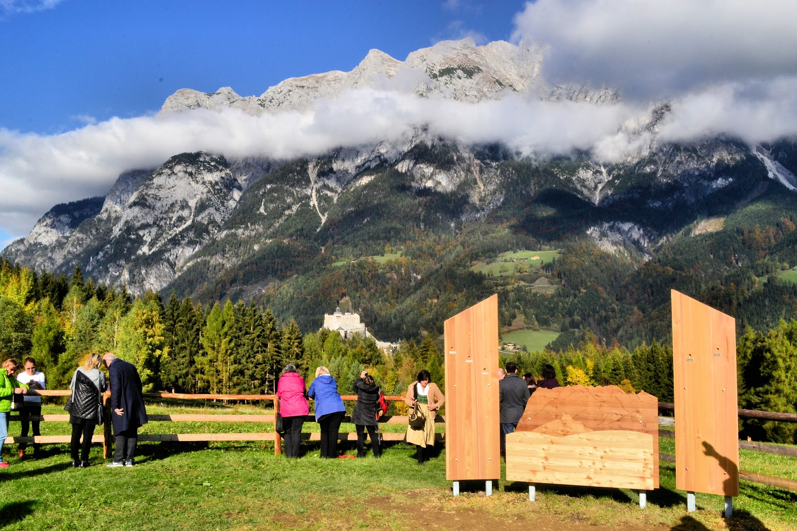 The Gschwandtanger Meadow is the last stop on the Sound of Music Trail in Werfen, Austria. The signage at the right is actually a map of the surrounding peaks and flanking each side are cleverly designed panels with little windows allowing you to take a peek of a peak in the background. Each peak hole identifies the mountain beyond.