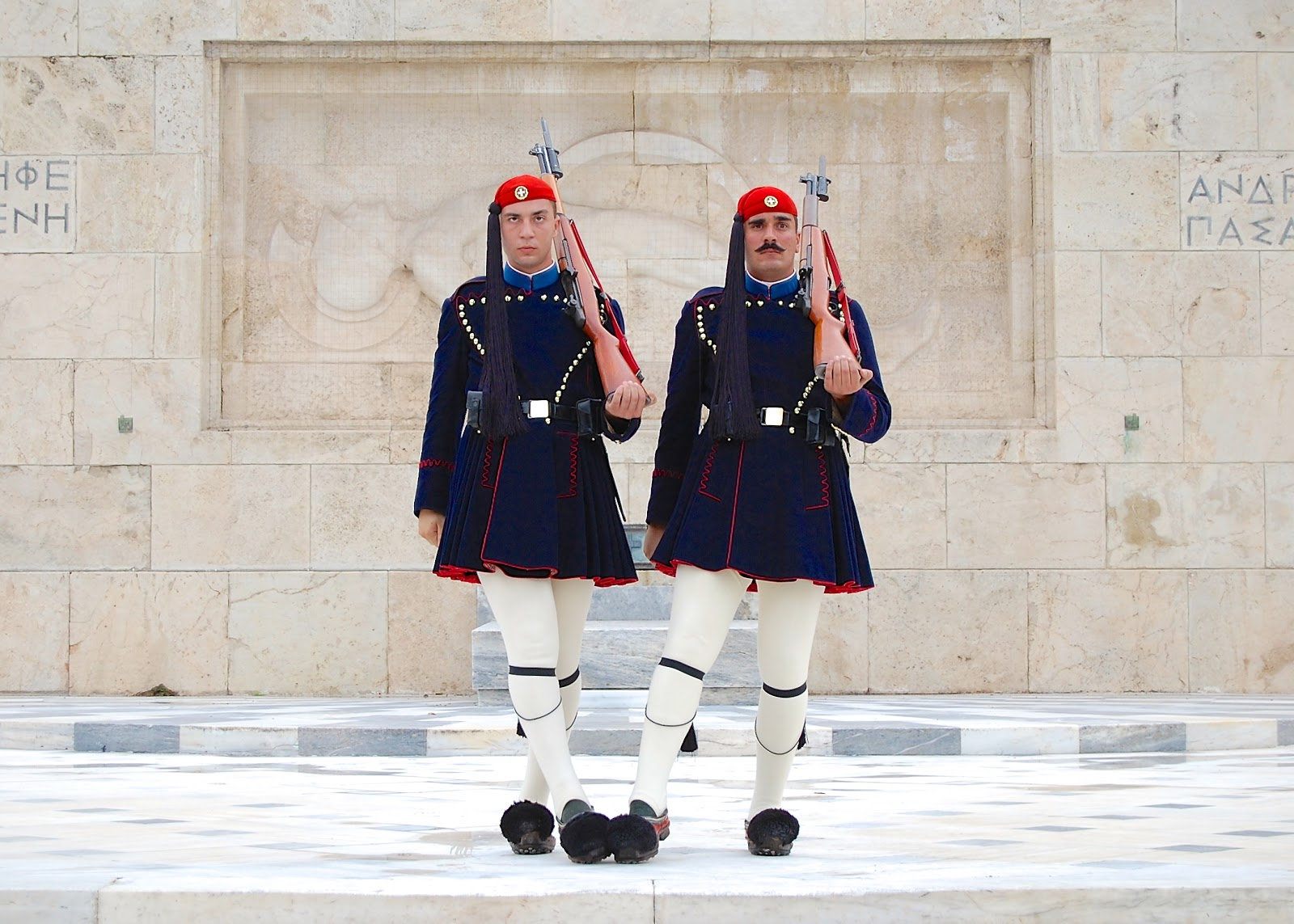 Soldiers touch toes at Athen's Tomb of the Unknown Soldier