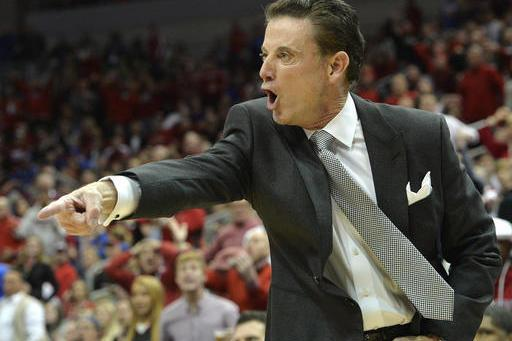 Louisville coach Rick Pitino restrained during verbal spat with UNC fan