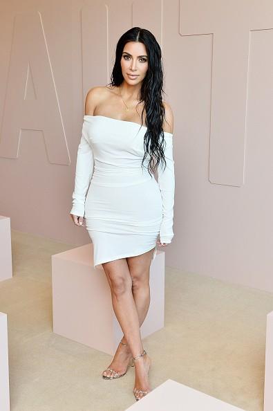 Kim Kardashian Flaunts Her Epic Figure in White Dress