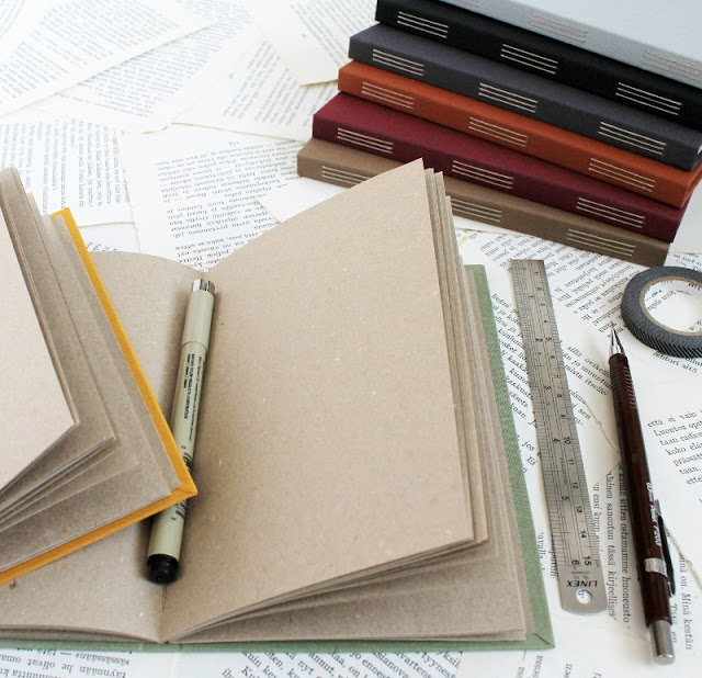long stitch bullet journals with recycled brown pages and cloth covers - by Kaija Rantakari / paperiaarre.com
