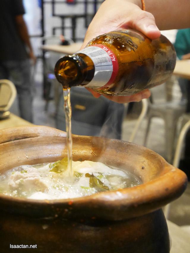 Adding in Thai Beer for that enhanced taste