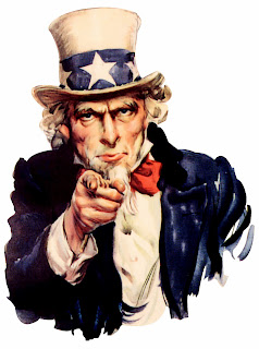 Uncle Sam, thin bearded man, wearing cream colored top hat, with starred head band, blue coat and red and white striped waistcoat, pointing out of the picture towards you.