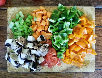 Assorted chopped vegetables on a chopping board