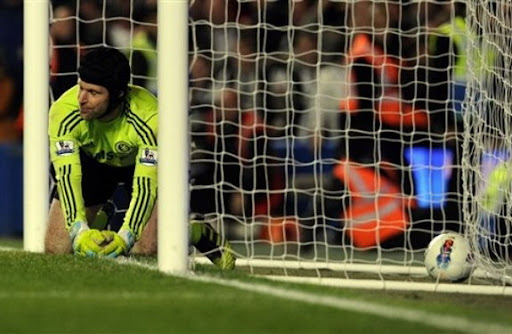 Chelsea goalkeeper Petr Čech reacts after conceding a goal from Newcastle player Papiss Cissé