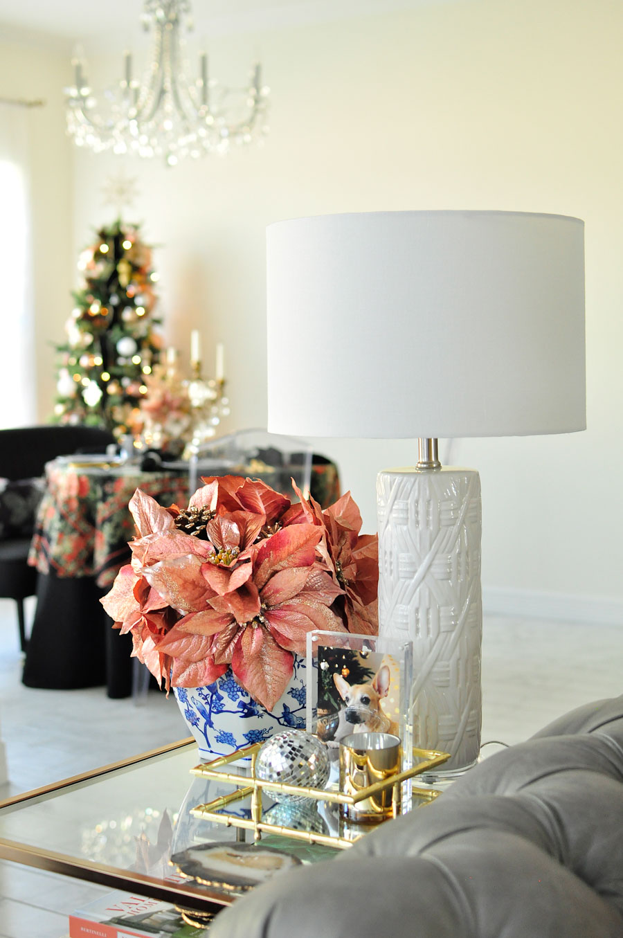 Blush poinsettias (rose gold) in a ginger jar atop a gold or brass glass end table. Love the chinoiserie touches.