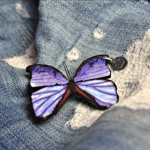 paper butterfly brooch on distressed denim