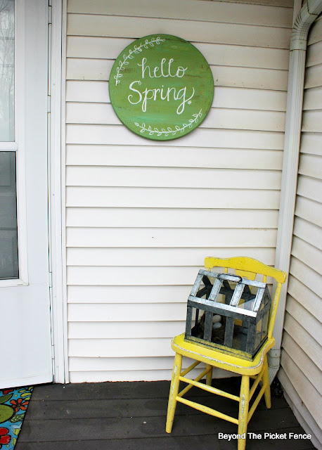 add spring decor to your porch a bit at a time