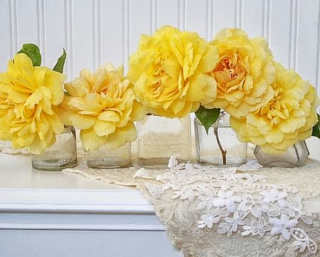 yellow roses in vases