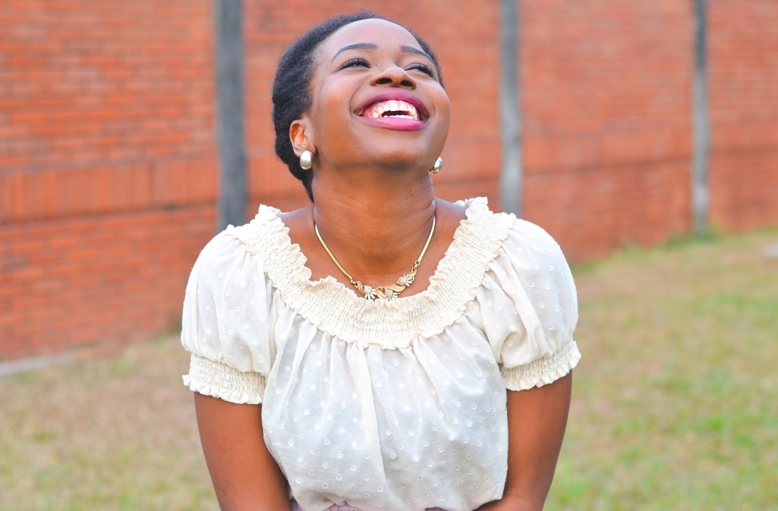 Black Girl laughing with head to the sky