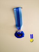 Foto medalla de fimo del Monstruo de las Galletas