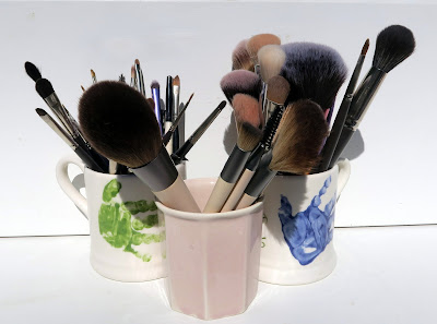 Make-up brushes in pots