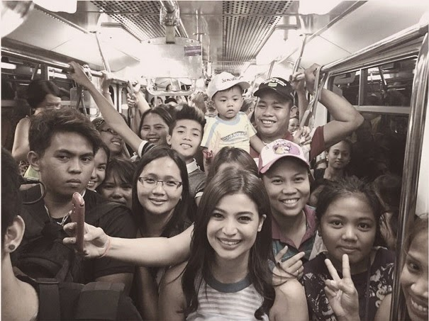IN PHOTOS: Anne Curtis rides MRT to attend fundraising event