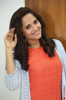 Actress Anasuya Bharadwaj in Orange Short Dress Glam Pics at Winner Movie Press Meet February 2017 (77).JPG