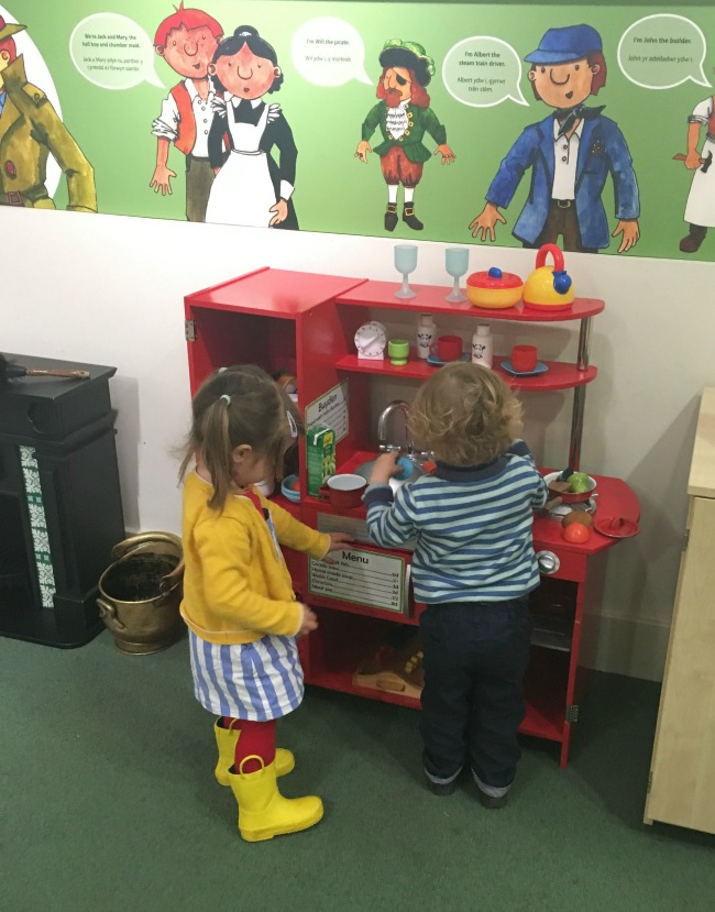 our-week-of-plays-toddlers-plying-with-toy-kitchen-at-Cardiff-story-museum