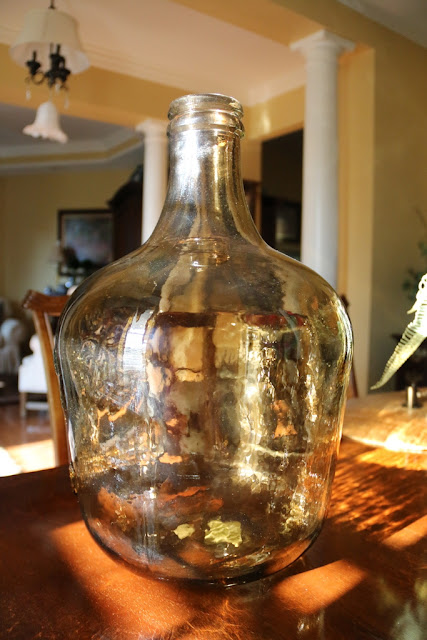 large amber glass jug