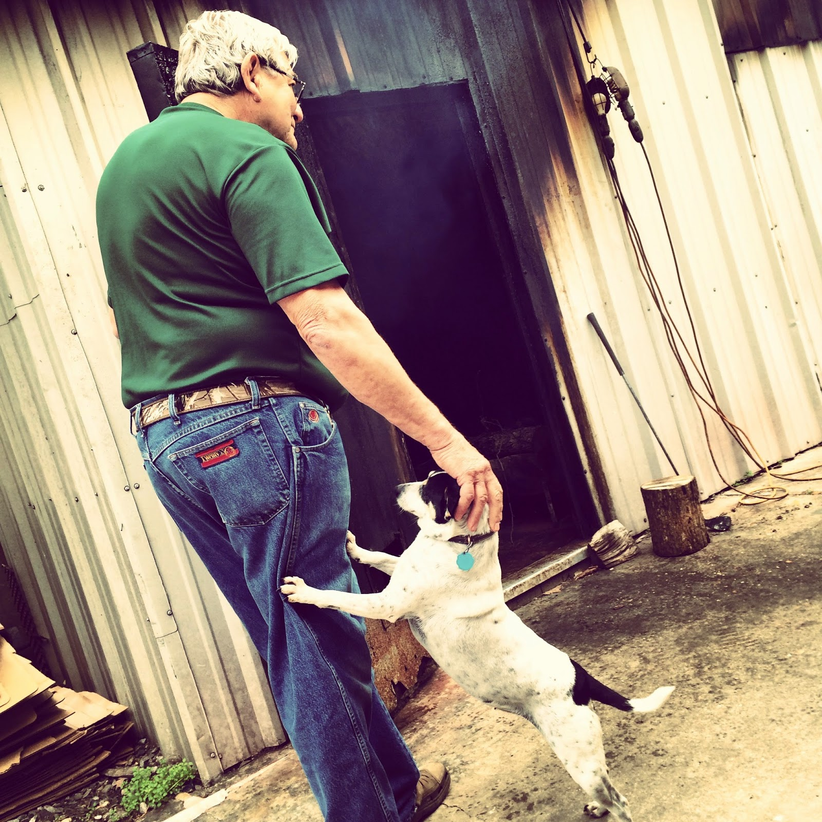 Kermit Lejeune and his faithful companion check the smokehouse at Lejeune's