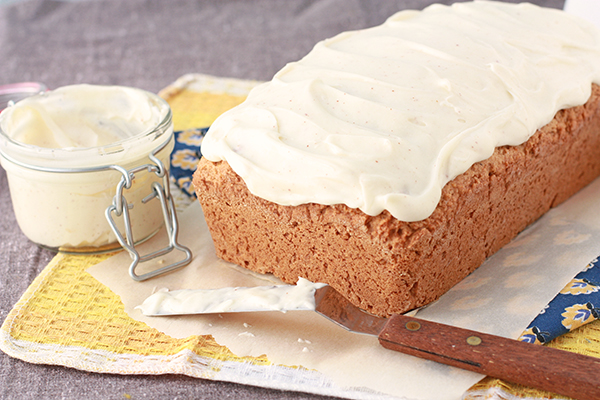 whole wheat pumpkin bread topped with cream cheese frosting