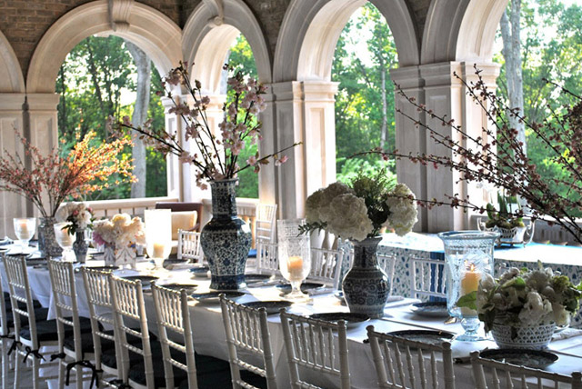 Elegant long table and chairs on French chateau loggia with archways at Enchanted Home
