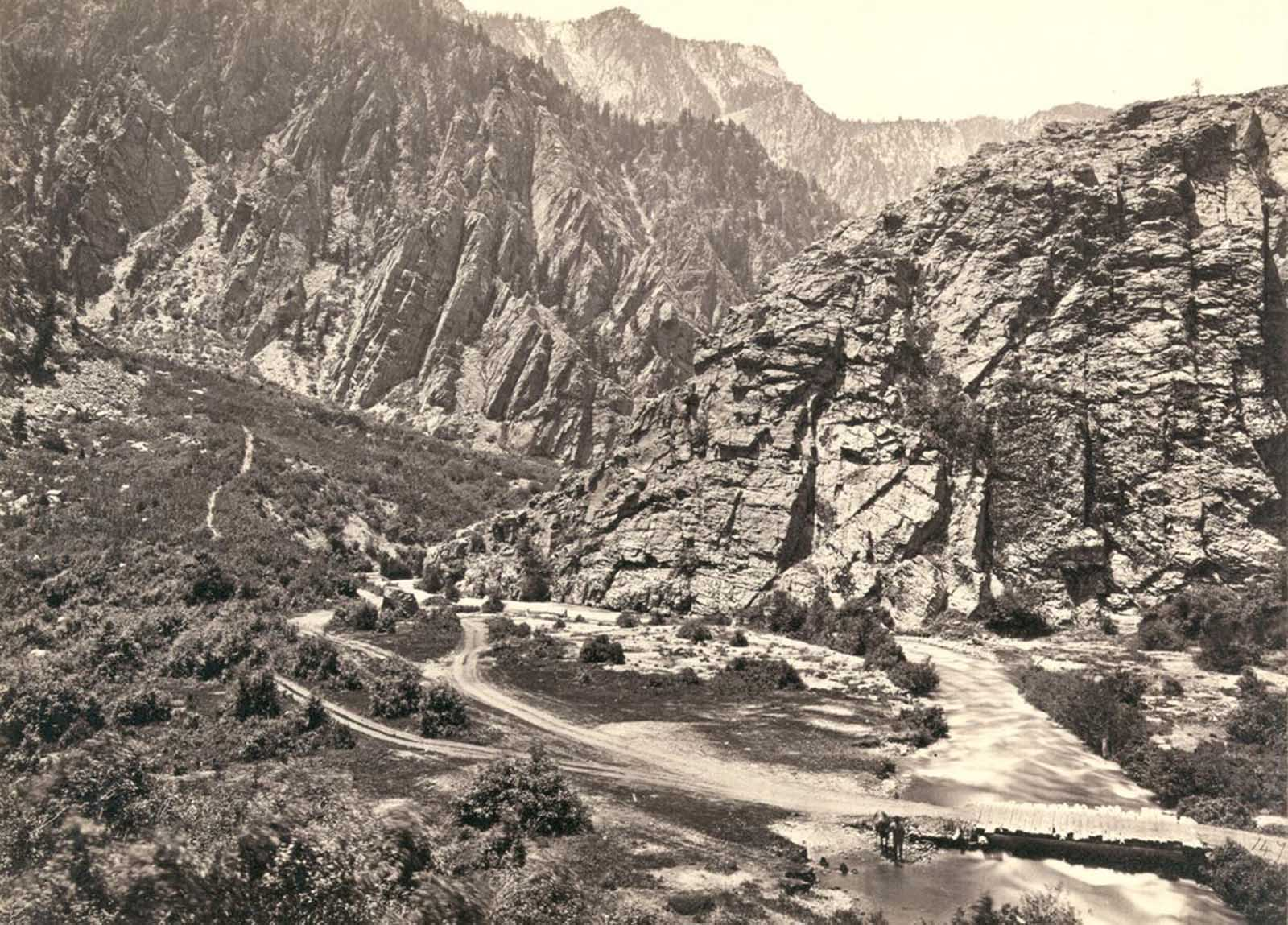 Big Cottonwood Canyon, Utah, in 1869. Note man and horse near the bridge at bottom right.