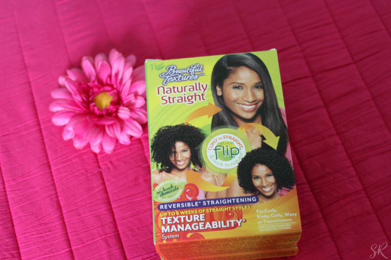 a picture of a black hair straightening kit on a pink cloth