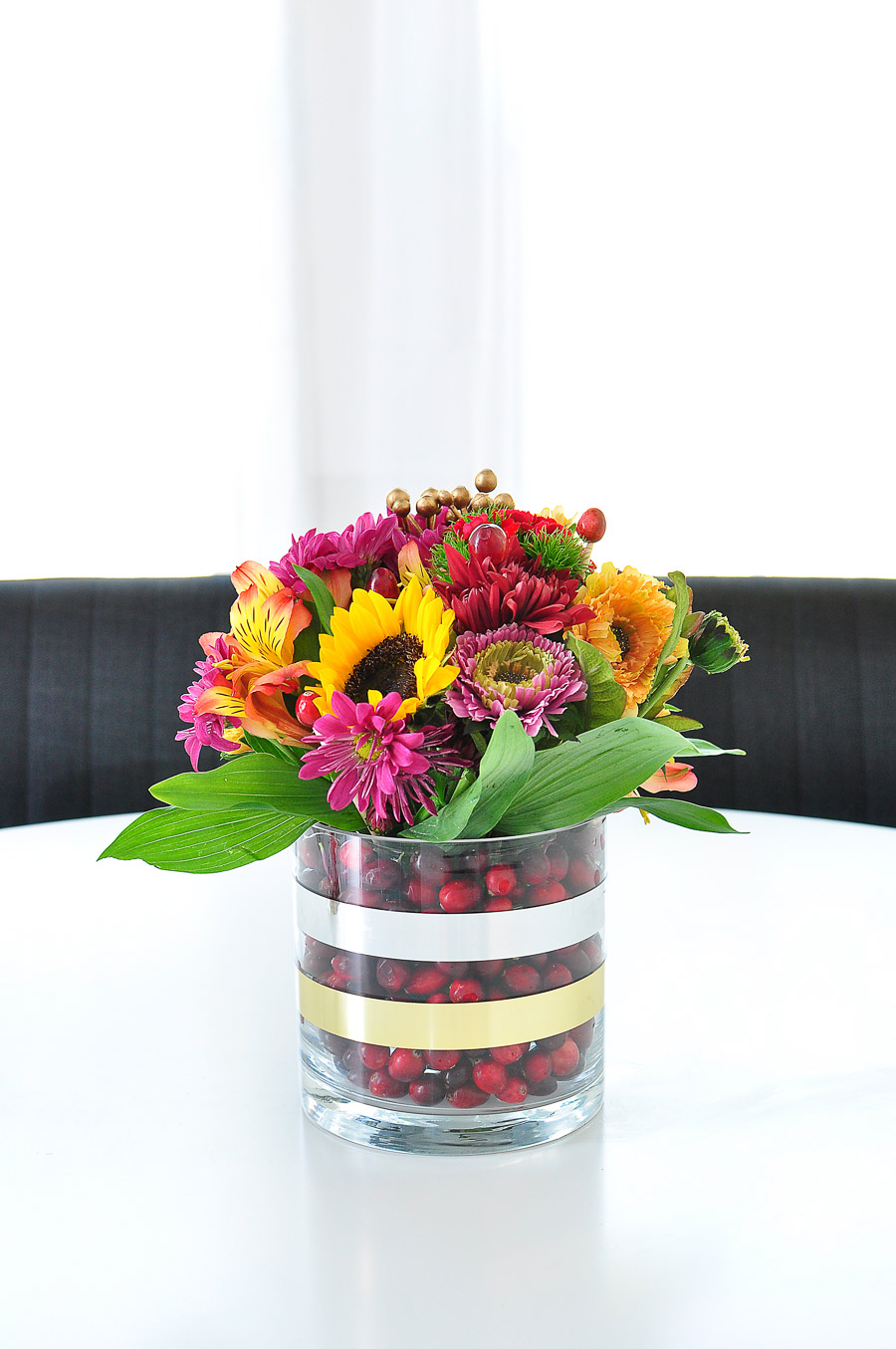 Cranberry vase with bold fall flowers for a centerpiece or tablescape decor. | #flowerarrangements #diningroom #flowerdesign #diningroomdecorideas #monicawantsit