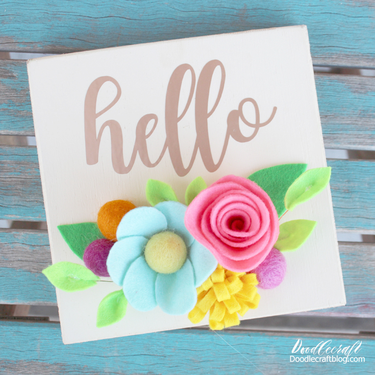 Bright vivid flowers add so much brilliance to a wood hello sign