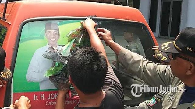 Bawaslu Copot Stiker Jokowi - Ma'ruf di Angkutan Umum