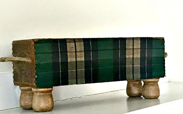 Upcycled old cream cheese crate with stained green plaid fabric. Homeroad.net