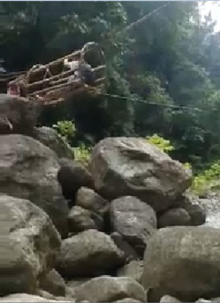Kids Forced to Use Rattan 'Cage Bridge' to Cross Dangerous River