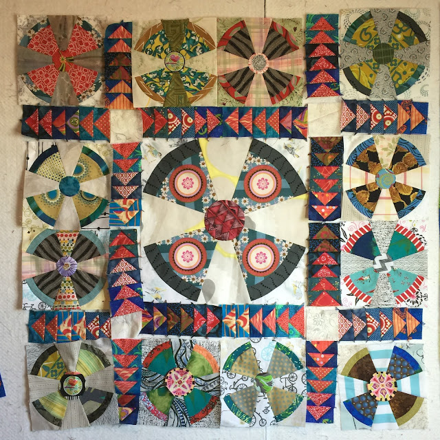 Propeller baby quilt with flying geese sashing